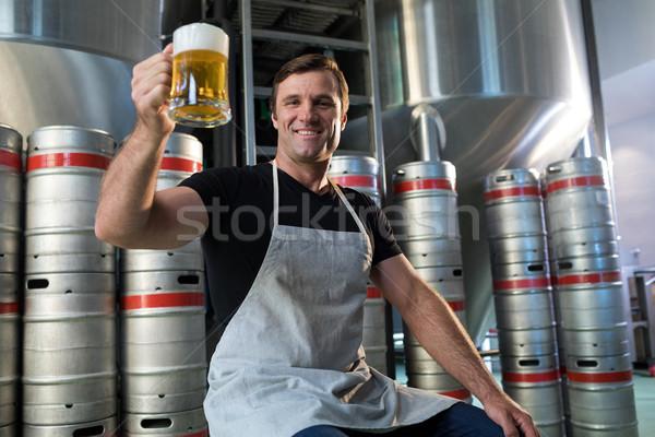Portrait of smiling worker holding beer glass Stock photo © wavebreak_media