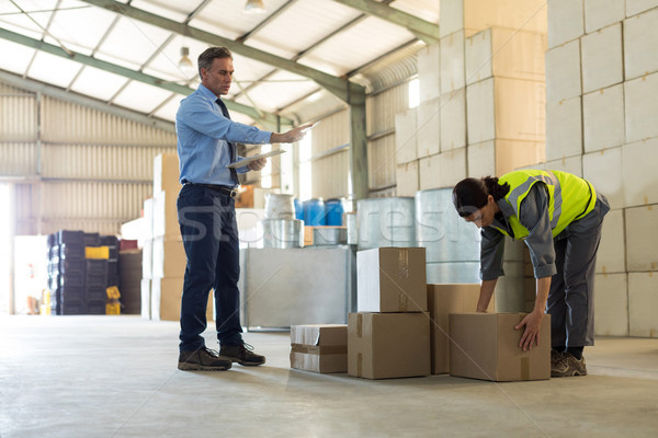 Manager instructing female worker while working Stock photo © wavebreak_media