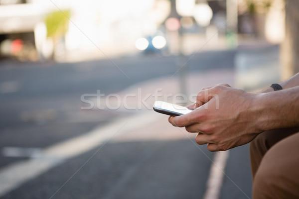 Hands of man using phone Stock photo © wavebreak_media