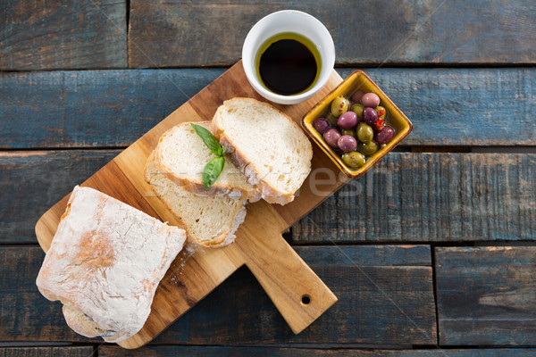 Pickled olives with bread and olive oil Stock photo © wavebreak_media