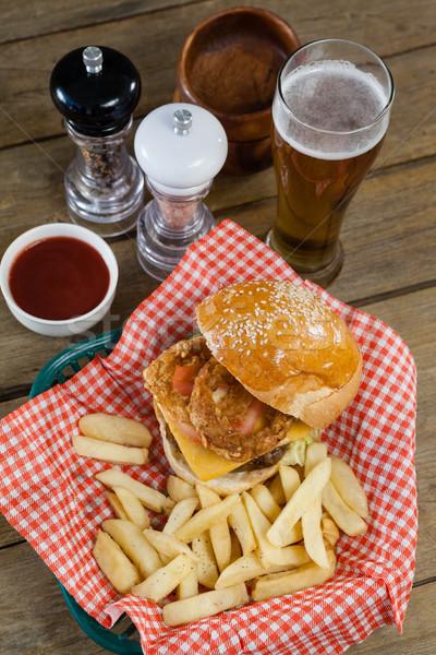 ハンバーガー フライドポテト バスケット 木製のテーブル ビール ストックフォト © wavebreak_media