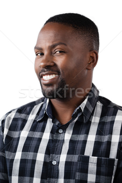 Stock photo: Happy man standing against white background