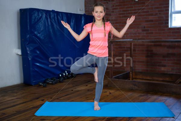Stock photo: Portrait of teenage girl practicing yoga