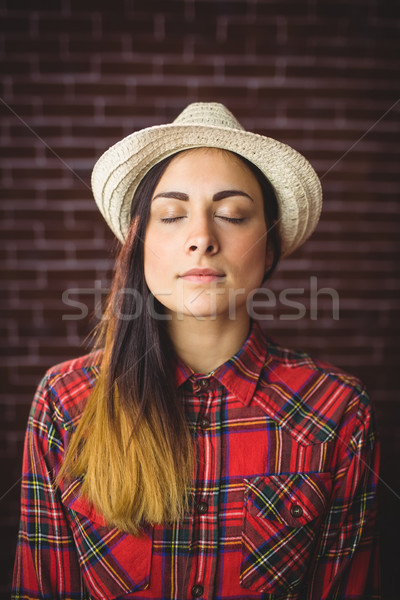 Beautiful hipster with eyes closed Stock photo © wavebreak_media