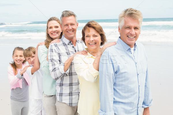 Többgenerációs család áll vmi mellett egy másik tengerpart Stock fotó © wavebreak_media