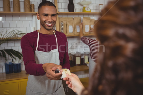 Owner receiving payment from customer in cafe Stock photo © wavebreak_media