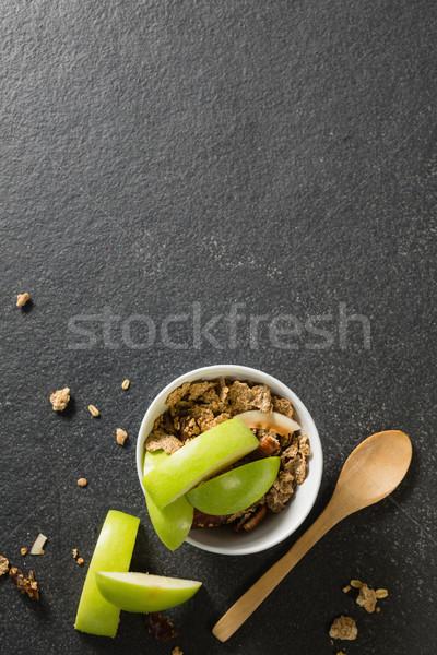 Tigela café da manhã cereais frutas preto papel Foto stock © wavebreak_media