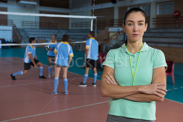 Portrait of coach by volleyball players at court Stock photo © wavebreak_media