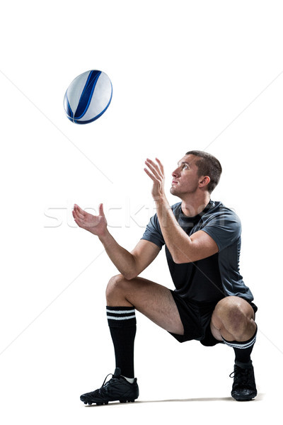 Full length of rugby player catching the ball Stock photo © wavebreak_media