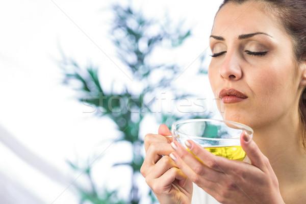 Woman smelling herbal tea with eyes closed Stock photo © wavebreak_media