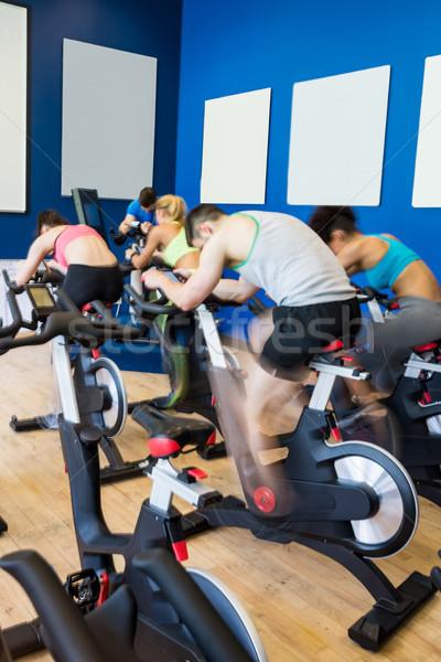 Geschikt mensen spinnen klasse gymnasium vrouw Stockfoto © wavebreak_media