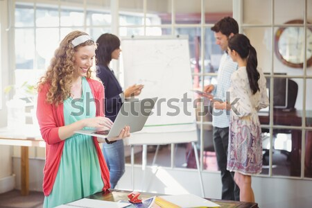 Creative businessteam working hard together Stock photo © wavebreak_media