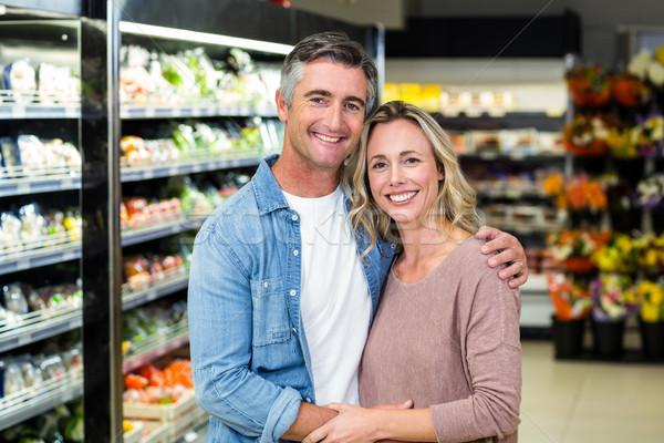 Mosolyog pár ölel gyümölcs folyosó áruház Stock fotó © wavebreak_media