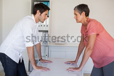 Student holding exercise mat interacting with instructor in health club Stock photo © wavebreak_media