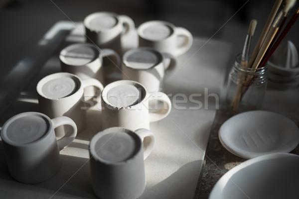 Close-up of ceramic mugs arranged on worktop Stock photo © wavebreak_media