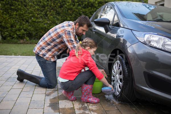 Teenage girl and father washing a car Stock photo © wavebreak_media