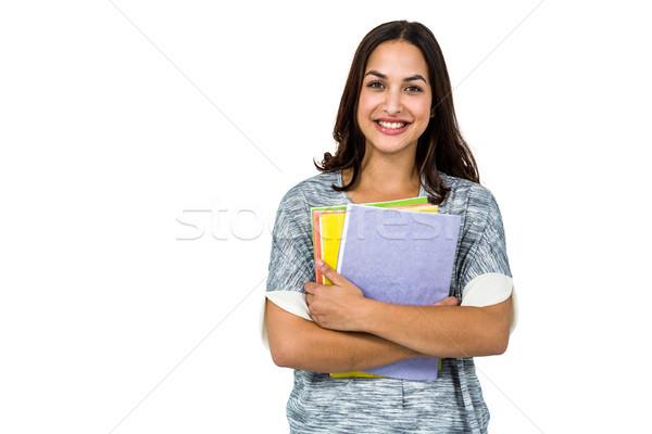 Portrait of smiling woman holding books Stock photo © wavebreak_media