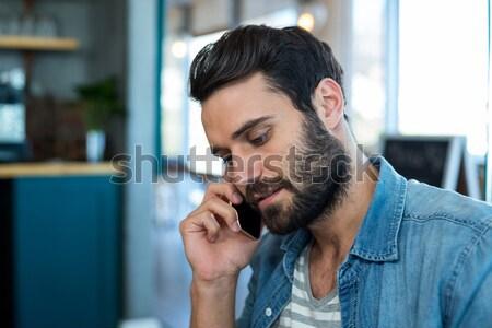 Hombre guapo casa hombre casa salón sofá Foto stock © wavebreak_media