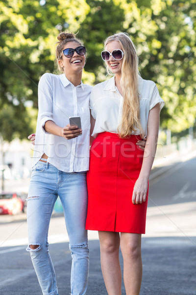 Hip woman looking at smartphone Stock photo © wavebreak_media