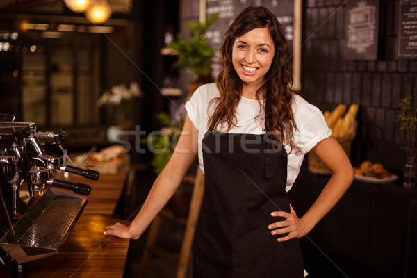 Pretty waitress posing next to coffee machine Stock photo © wavebreak_media