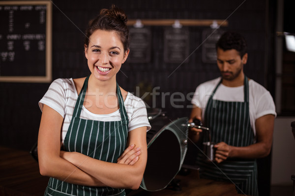 Smiling barista standing with arms crossed Stock photo © wavebreak_media