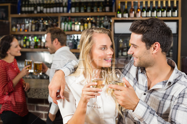 Couple looking at each other and toasting Stock photo © wavebreak_media