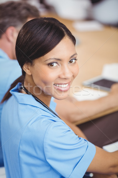 Happy female doctor sitting on conference room Stock photo © wavebreak_media