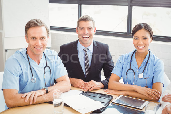 Stock photo: Portrait of medical team smiling in conference room