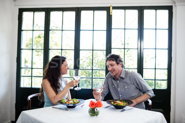 Couple holding wine glass and interacting Stock photo © wavebreak_media