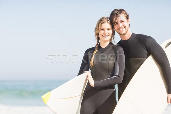Portré pár szörfdeszka áll tengerpart napos idő Stock fotó © wavebreak_media