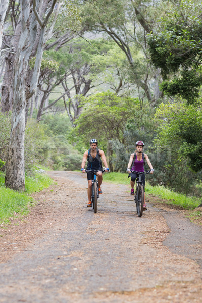 Man and woman riding bike in forest Stock photo © wavebreak_media