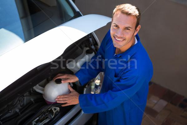 Mechanic examining the car  Stock photo © wavebreak_media