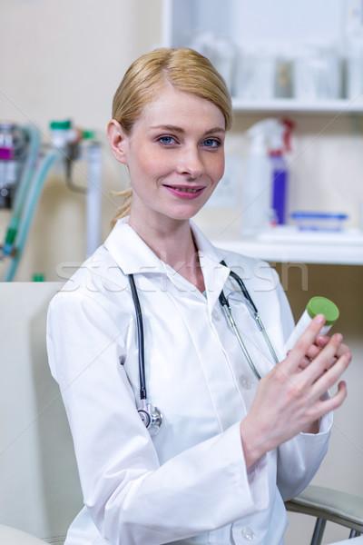 Portrait of woman vet bringing a retrieved sample Stock photo © wavebreak_media