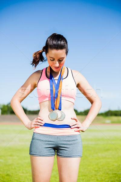Female athlete with gold medals around her neck Stock photo © wavebreak_media