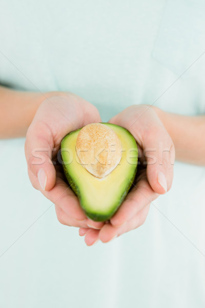 Woman holding avocado fruit Stock photo © wavebreak_media