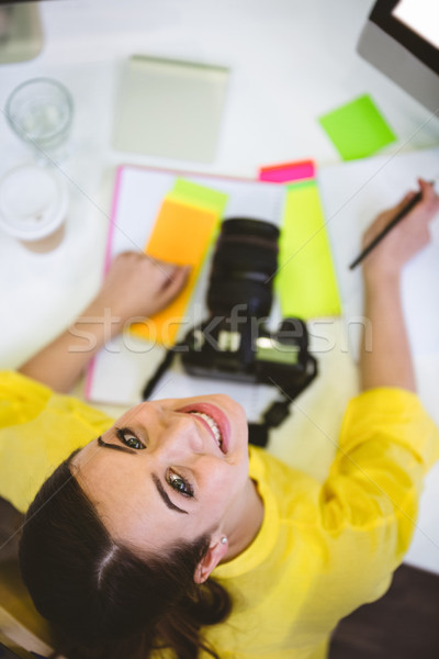 Portrait of happy photo editor sitting at office Stock photo © wavebreak_media