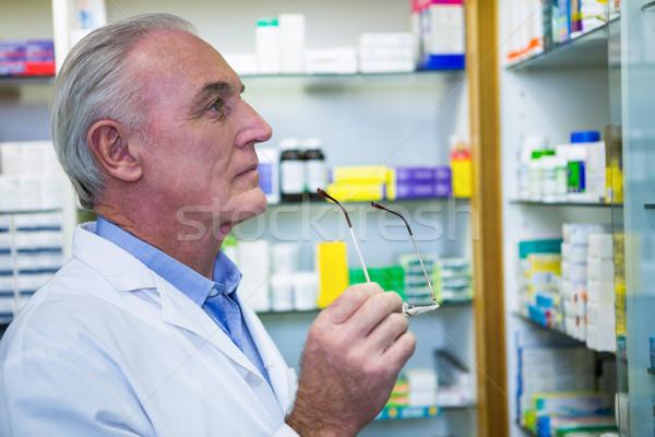 Pharmacist checking medicines in pharmacy Stock photo © wavebreak_media