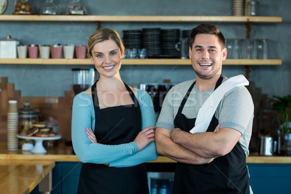 Portrait of smiling waiter and waitress standing with arms crossed Stock photo © wavebreak_media