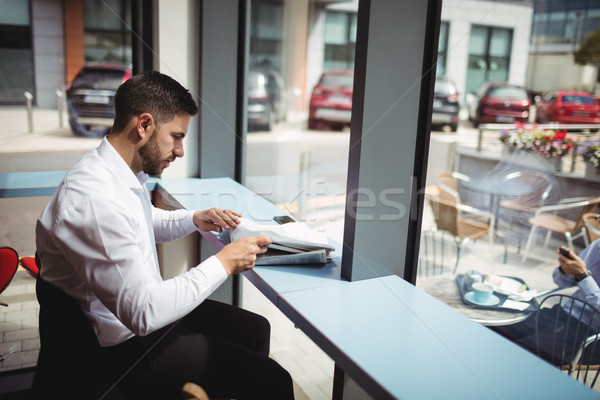 Stock photo: Businessman reading newspaper in office
