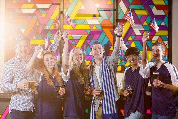 Csoport barátok tart amerikai zászló buli mosolyog Stock fotó © wavebreak_media