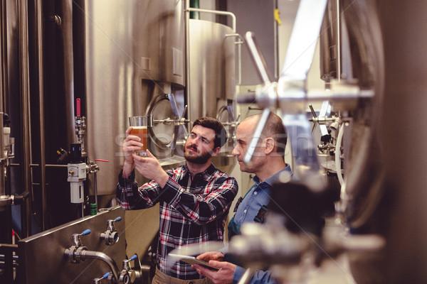 Owner and worker examining beer in glass Stock photo © wavebreak_media