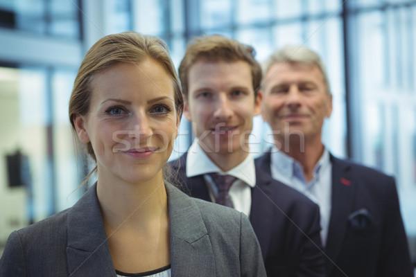 Businesswoman standing in the office Stock photo © wavebreak_media