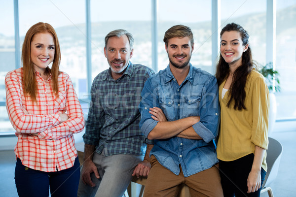Portrait of creative business team leaning on the table Stock photo © wavebreak_media