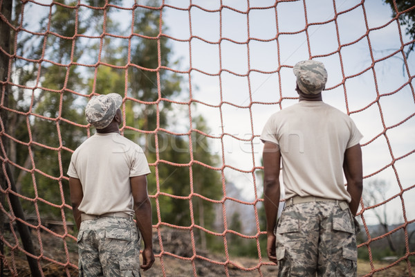 Military soldiers looking at net during obstacle course Stock photo © wavebreak_media