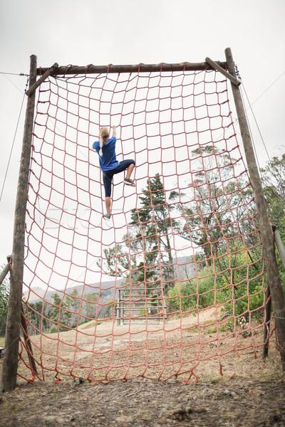 Nő mászik net akadályfutás fa fitnessz Stock fotó © wavebreak_media