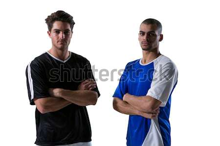 Two football players standing with arms crossed Stock photo © wavebreak_media