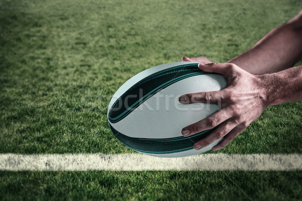 Composite image of cropped image of sports player holding ball Stock photo © wavebreak_media