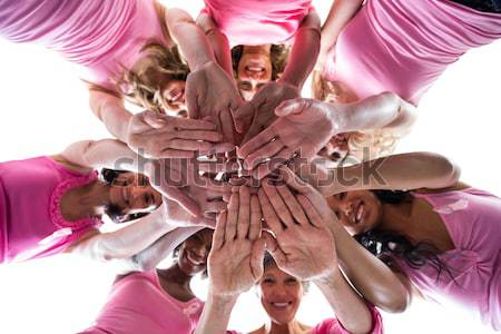 Stock photo: Women joining hands for breast cancer awareness