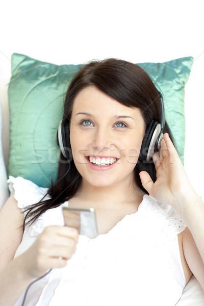 Radosny kobieta słuchania muzyki sofa domu Zdjęcia stock © wavebreak_media
