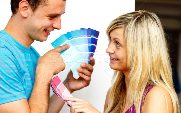 Couple with colour samples to paint new apartment. Concept of de Stock photo © wavebreak_media